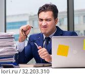 Купить «Workaholic businessman overworked with too much work in office», фото № 32203310, снято 11 октября 2016 г. (c) Elnur / Фотобанк Лори