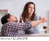 Domestic violence concept in a family argument with drunk alcoho. Стоковое фото, фотограф Elnur / Фотобанк Лори
