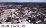 Купить «Top view of a cement factory near the city Bunol. Spain», видеоролик № 32205150, снято 24 апреля 2019 г. (c) Яков Филимонов / Фотобанк Лори