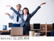 Купить «Two employees doing sport exercises in the office», фото № 32205454, снято 6 мая 2019 г. (c) Elnur / Фотобанк Лори