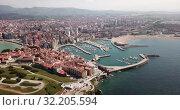 Купить «Panoramic aerial view of Gijon on Atlantic ocean coast overlooking of marina with moored pleasure yachts, Spain», видеоролик № 32205594, снято 15 июля 2019 г. (c) Яков Филимонов / Фотобанк Лори