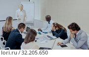 Купить «Angry female boss reprehending colleagues on meeting in modern office», видеоролик № 32205650, снято 7 декабря 2019 г. (c) Яков Филимонов / Фотобанк Лори