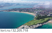 Купить «Scenic view from drone of coastal Spanish town of Santander on sunny summer day, Cantabria», видеоролик № 32205718, снято 14 июля 2019 г. (c) Яков Филимонов / Фотобанк Лори