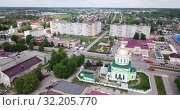 Купить «View from drone of Ozyory cityscape with golden dome of Holy Trinity Church on spring day, Russia», видеоролик № 32205770, снято 13 мая 2019 г. (c) Яков Филимонов / Фотобанк Лори