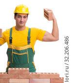 Купить «The handsome construction worker building brick wall», фото № 32206486, снято 5 ноября 2016 г. (c) Elnur / Фотобанк Лори