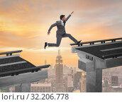 Купить «Young businessman jumping over the bridge», фото № 32206778, снято 28 января 2020 г. (c) Elnur / Фотобанк Лори