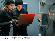 Купить «Two robbers with laptop trying to open the vault», фото № 32207238, снято 3 июня 2019 г. (c) Tryapitsyn Sergiy / Фотобанк Лори