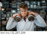 Купить «Scientist holds radiation devices in his hands», фото № 32207294, снято 17 июня 2019 г. (c) Tryapitsyn Sergiy / Фотобанк Лори