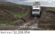 Купить «Russian off-road extreme expedition truck KamAZ driving on muddy mountain road», видеоролик № 32208054, снято 16 августа 2019 г. (c) А. А. Пирагис / Фотобанк Лори