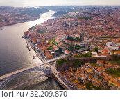 Купить «Porto city view with Douro river and Dom Luis I bridge, Portugal», фото № 32209870, снято 17 июня 2019 г. (c) Яков Филимонов / Фотобанк Лори