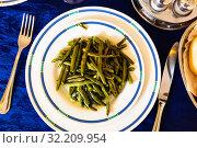 Купить «Portion of stewed green beans», фото № 32209954, снято 19 октября 2019 г. (c) Яков Филимонов / Фотобанк Лори