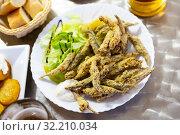 Купить «Closeup of fried anchovies food with sauce», фото № 32210034, снято 13 октября 2019 г. (c) Яков Филимонов / Фотобанк Лори