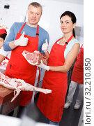 Купить «Adult sellers satisfied of quality meat in shop», фото № 32210850, снято 22 июня 2018 г. (c) Яков Филимонов / Фотобанк Лори