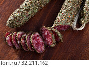 Fuet sausage coated with herbs. Стоковое фото, фотограф Яков Филимонов / Фотобанк Лори