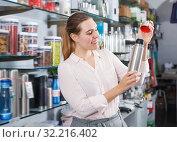 Купить «Glad woman consumer with thermos», фото № 32216402, снято 2 мая 2018 г. (c) Яков Филимонов / Фотобанк Лори