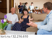 Купить «Happy family gathered in parental home», фото № 32216610, снято 17 августа 2019 г. (c) Яков Филимонов / Фотобанк Лори