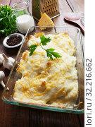 Купить «Casserole with fish and potatoes», фото № 32216662, снято 19 марта 2019 г. (c) Надежда Мишкова / Фотобанк Лори
