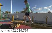 Купить «Child having fun at outdoor playground», видеоролик № 32216786, снято 15 октября 2019 г. (c) Данил Руденко / Фотобанк Лори
