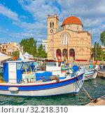 Купить «Fshing boats and waterfront with church in Aegina town», фото № 32218310, снято 13 сентября 2019 г. (c) Роман Сигаев / Фотобанк Лори