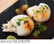 Купить «Roasted sepia served with shrimps», фото № 32218970, снято 9 июля 2020 г. (c) Яков Филимонов / Фотобанк Лори