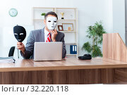 Купить «Businessman wearing mask in hypocrisy concept», фото № 32220118, снято 24 июня 2019 г. (c) Elnur / Фотобанк Лори