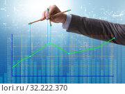 Купить «Businessman controlling the market with strings», фото № 32222370, снято 5 декабря 2019 г. (c) Elnur / Фотобанк Лори