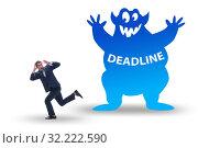 Купить «Businessman missing important deadline with monster», фото № 32222590, снято 14 октября 2019 г. (c) Elnur / Фотобанк Лори