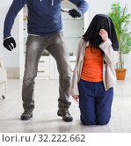 Купить «Armed man assaulting young woman at home», фото № 32222662, снято 15 декабря 2017 г. (c) Elnur / Фотобанк Лори