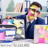 Купить «Businessman with reminder notes in multitasking concept», фото № 32222882, снято 26 сентября 2017 г. (c) Elnur / Фотобанк Лори