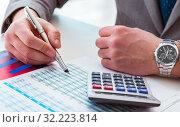 Купить «Finance analyst looking and financial reports», фото № 32223814, снято 2 марта 2017 г. (c) Elnur / Фотобанк Лори