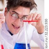 Купить «Mad crazy scientist doctor doing experiments in a laboratory», фото № 32223930, снято 19 января 2017 г. (c) Elnur / Фотобанк Лори