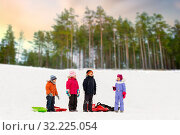 Купить «happy little kids with sleds in winter», фото № 32225054, снято 10 февраля 2018 г. (c) Syda Productions / Фотобанк Лори