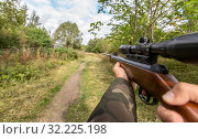 Купить «POV of male hands shooting with air rifle», фото № 32225198, снято 18 сентября 2019 г. (c) Syda Productions / Фотобанк Лори