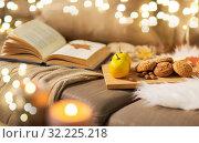 Купить «lemons, book, almond and oatmeal cookies on sofa», фото № 32225218, снято 15 ноября 2017 г. (c) Syda Productions / Фотобанк Лори