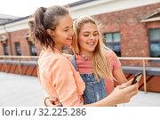Купить «teenage girls listening to music on smartphone», фото № 32225286, снято 20 июня 2019 г. (c) Syda Productions / Фотобанк Лори