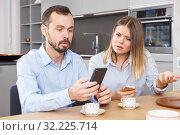 Купить «Irritated spouses with phones», фото № 32225714, снято 24 мая 2018 г. (c) Яков Филимонов / Фотобанк Лори