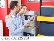 Купить «couple choosing home safe box», фото № 32225834, снято 17 апреля 2018 г. (c) Яков Филимонов / Фотобанк Лори