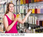 Купить «woman take a choise fresh liquid soap in perfume supermarket», фото № 32225958, снято 2 мая 2017 г. (c) Яков Филимонов / Фотобанк Лори