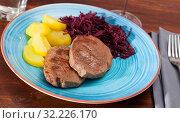 Купить «Veal steaks with potato and marinated cabbage», фото № 32226170, снято 17 ноября 2019 г. (c) Яков Филимонов / Фотобанк Лори