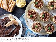 portions of tiramisu, italian dessert in glasses. Стоковое фото, фотограф Oksana Zh / Фотобанк Лори