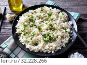 Купить «close-up of tasty Cauliflower rice or couscous», фото № 32228266, снято 8 мая 2019 г. (c) Oksana Zh / Фотобанк Лори
