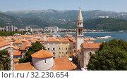 Купить «Budva, Montenegro - June 13.2019. Old Town and Cathedral of St. John the Baptist», видеоролик № 32230654, снято 27 сентября 2019 г. (c) Володина Ольга / Фотобанк Лори