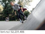Купить «Roller skating, young skater rolling off the ramp», фото № 32231406, снято 5 июня 2019 г. (c) Tryapitsyn Sergiy / Фотобанк Лори