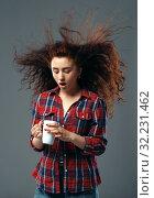 Купить «Strong wind blowing on woman's hair, funny grimace», фото № 32231462, снято 7 июня 2019 г. (c) Tryapitsyn Sergiy / Фотобанк Лори
