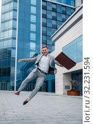Happy businessman at office building. Стоковое фото, фотограф Tryapitsyn Sergiy / Фотобанк Лори