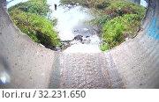Купить «Ливневая городская канализация (ливневка). Сточные воды», видеоролик № 32231650, снято 13 января 2013 г. (c) Mikhail Erguine / Фотобанк Лори