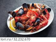 Купить «close-up of a mix a seafood on plate», фото № 32232670, снято 18 мая 2019 г. (c) Oksana Zh / Фотобанк Лори