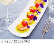 Купить «Tasty seafood ceviche from salmon with figs, kiwi and cumquat at plate», фото № 32232962, снято 21 октября 2019 г. (c) Яков Филимонов / Фотобанк Лори