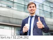 Купить «Portrait of cheerful male standing outdoor», фото № 32234282, снято 29 апреля 2017 г. (c) Яков Филимонов / Фотобанк Лори