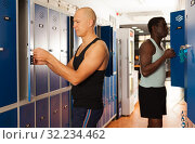Купить «Two athletes in the locker room after training», фото № 32234462, снято 28 января 2019 г. (c) Яков Филимонов / Фотобанк Лори